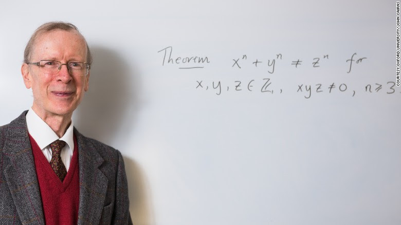Professor Andrew Wiles in front of a version of Fermat's Last Theorem
