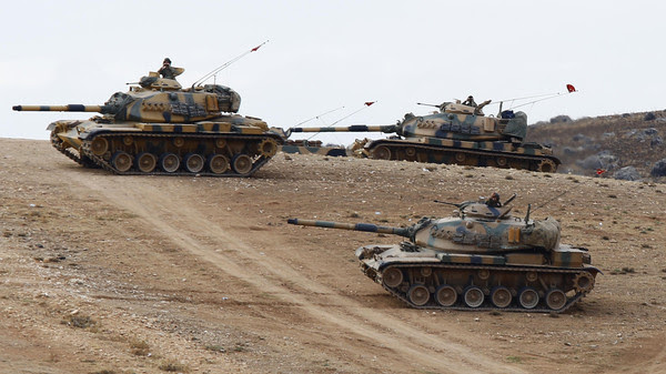 Turkish army tanks take up position on the Turkish-Syrian border near Suruc