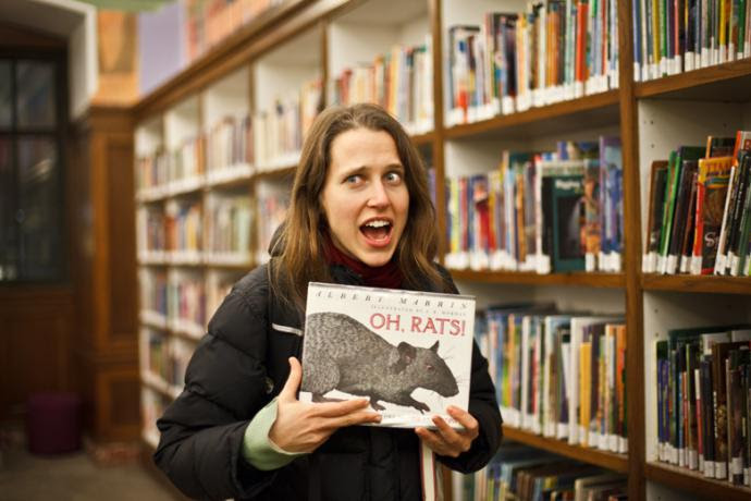 "Josephine Decker holding a book that says ""oh rats!"""