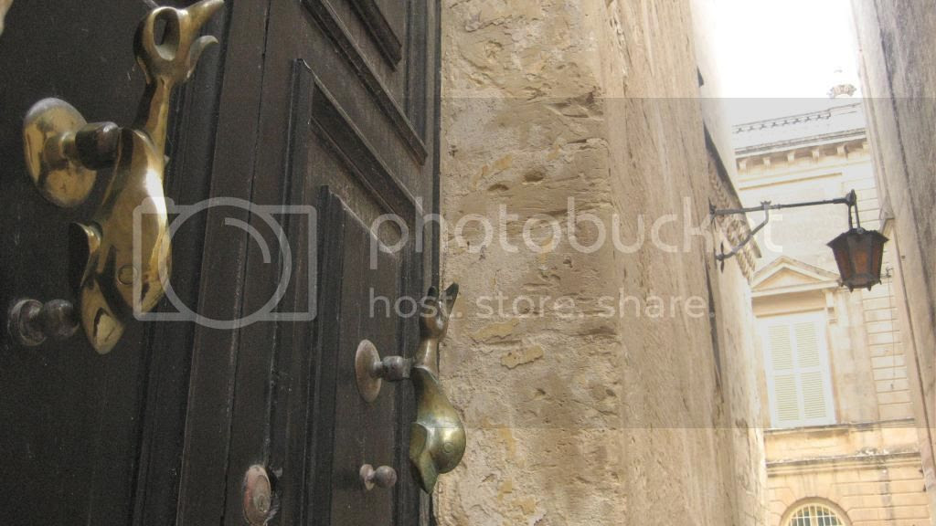 Traditional Maltese Dolphin Door Knocker.  Streets of Valletta, Malta.  Travel Blogger.