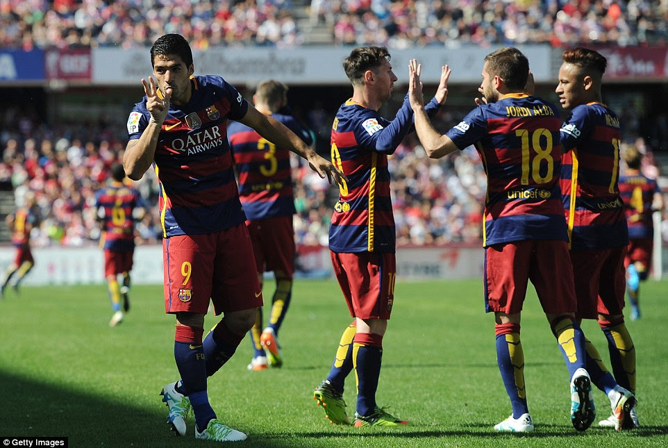 Suarez celebrates with his team-mates after scoring Barcelona's first goal at Estadio Nuevo Los Carmenes on Saturday