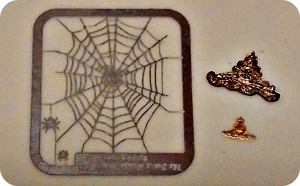 spider web and military badge from The Dolls House Mall