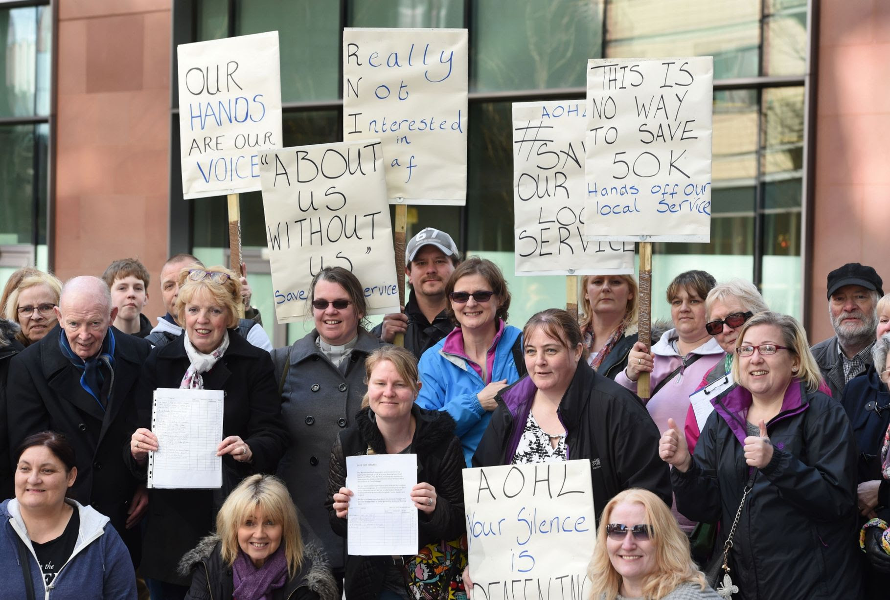 Members of the Merseyside deaf community and interpreters,protesting outside the Action On Hearing Loss offices on St Paul's Square,against the closing down of the Merseyside Communications Services office & relocation to Peterborough.