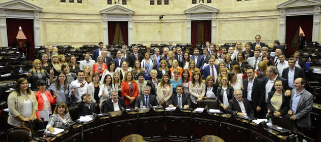 Legislators who supported the new law at four o'clock in the morning on Nov. 23, 2017 took a group photo when the historic session in Argentina's Chamber of Deputies ended, after passing a law that imposes gender parity in political representation. Credit: Chamber of Deputies of Argentina