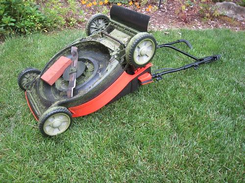 Sharpening a lawnmower blade.