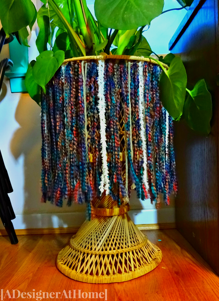 boho fringe yarn skirt on vintage wicker plant stand - handmade creativity - it's so ugly it's cool challenge - adesignerathome