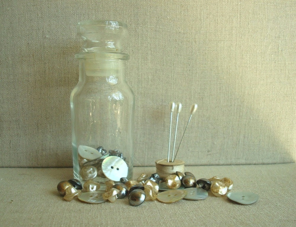 Buttons & notions in a vintage bottle