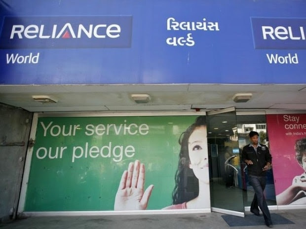 A customer leaves a Reliance communications store in Ahmedabad
