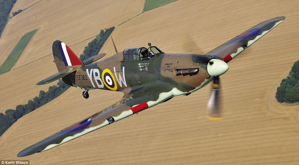 Soaring above: The LF363 Hurricane was photographed here during a special air-to-air photoshoot close to the south-east coast of England in August 2012