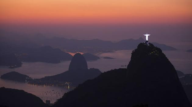 The Christ the Redeemer statue, located on the top of Corcovado Mountain and the Sugar Loaf Mountain, are seen from the Parque Nacional da Tijuca in Rio de Janeiro.
