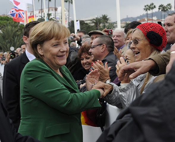 http://static.guim.co.uk/sys-images/Guardian/Pix/pictures/2011/11/3/1320320237421/German-Chancellor-Angela--007.jpg