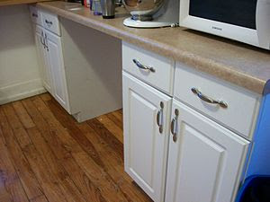 English: Handymen can install kitchen cabinets...