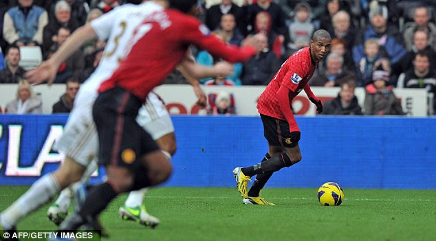 Looking for his man: Ashley Young prepares to cross the ball