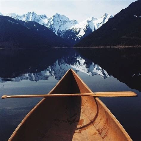 Canoe Below The Mountains Pictures, Photos, and Images for