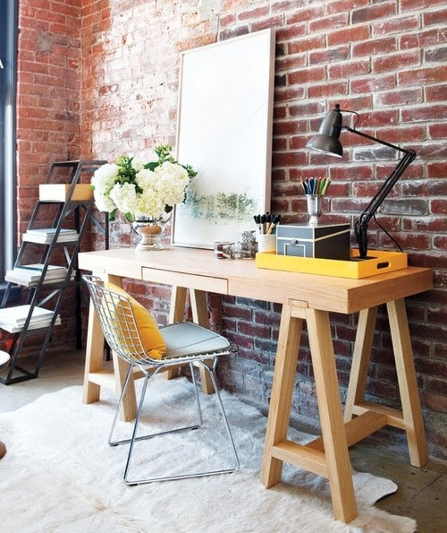 loft like office space design. Love that exposed brick wall.