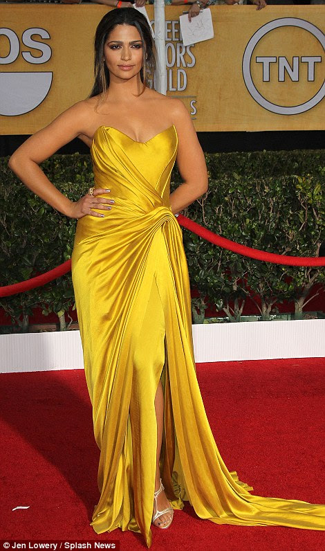 Strikingly beautiful: Camila Alves (left) said her draped yellow-gold strapless vintage Donna Karan Atelier gown was a last-minute choice, while Kaley Cuoco's dove grey fit and flare dress looked like it had been made for her