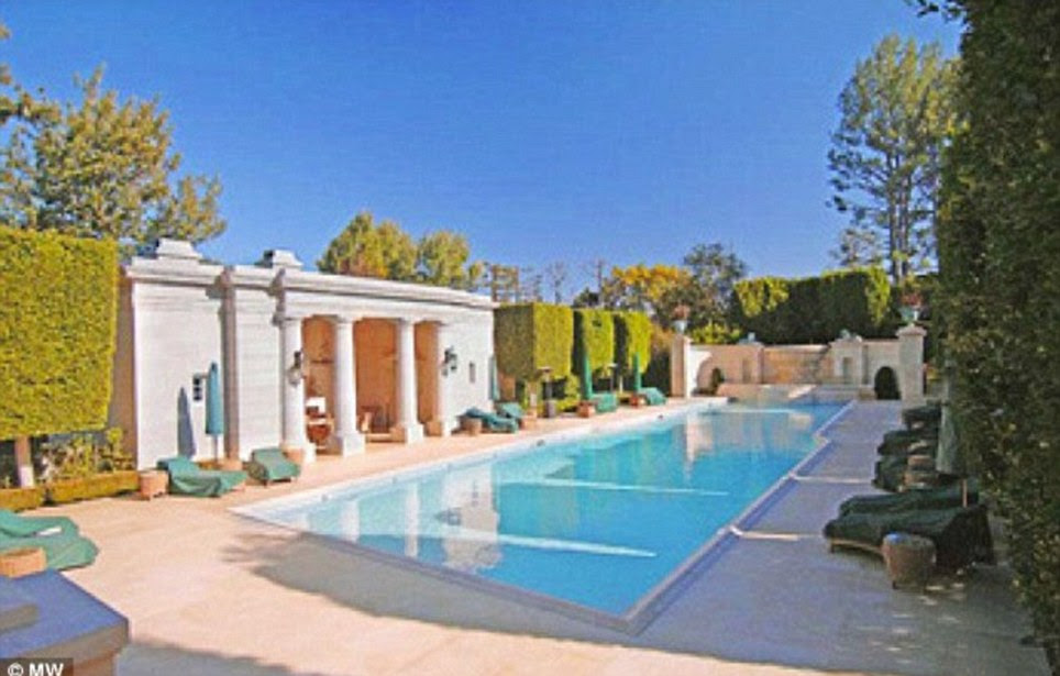 Outside the property boasts a spa pool with its own kitchen, an ornamental garden, a 1,200-metre running track, a championship tennis court and a folly ¿ plus private quarters to house  up to ten live-in domestic staff