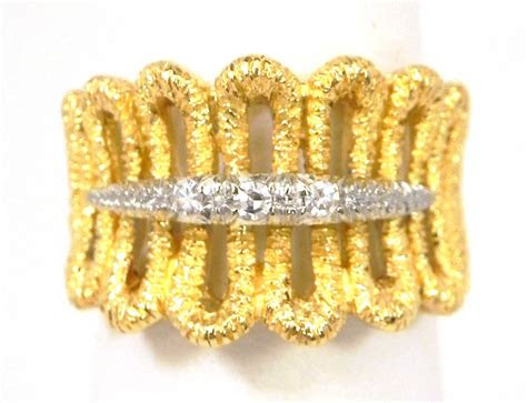 ladies  yellow gold loop style diamonds band ring