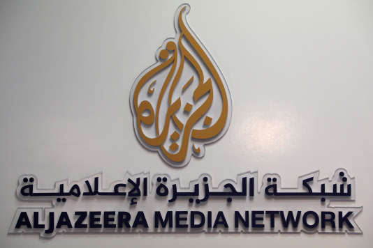 FILE PHOTO: The logo of Al Jazeera Media Network is seen during the annual MIPCOM television programme market in Cannes, France, October 17, 2016. REUTERS/Eric Gaillard/File Photo