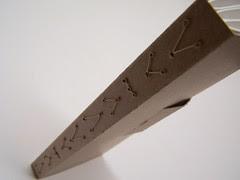 folding v's sewn binding