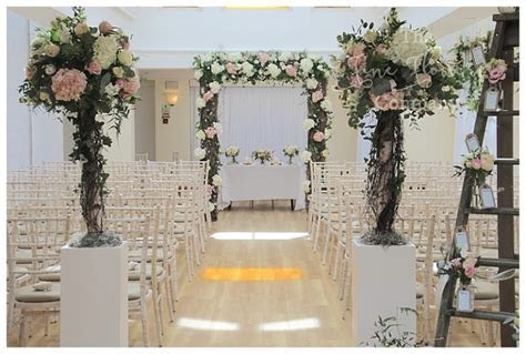 Rustic wedding arch at Pembroke Lodge   The Fine Flower