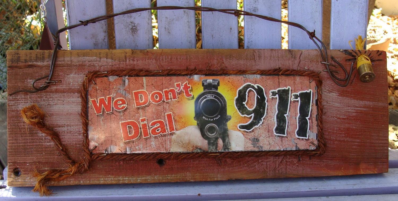 We Dont Dial 911 Shotgun Shell Tin and Wood Sign