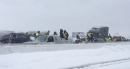 100-vehicle pileup on icy highway kills one person and injures several others