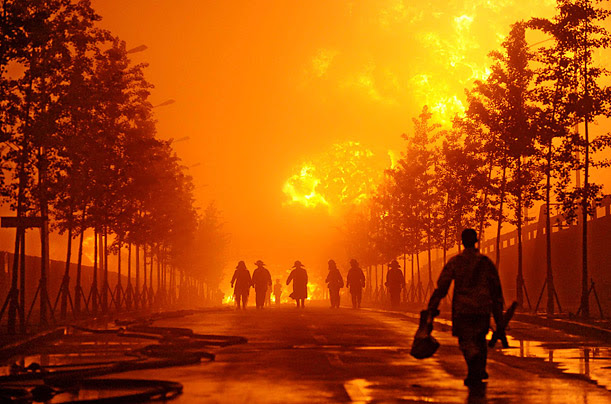 Firefighters approach an oil pipeline blast site in Dalian, China, July 17.