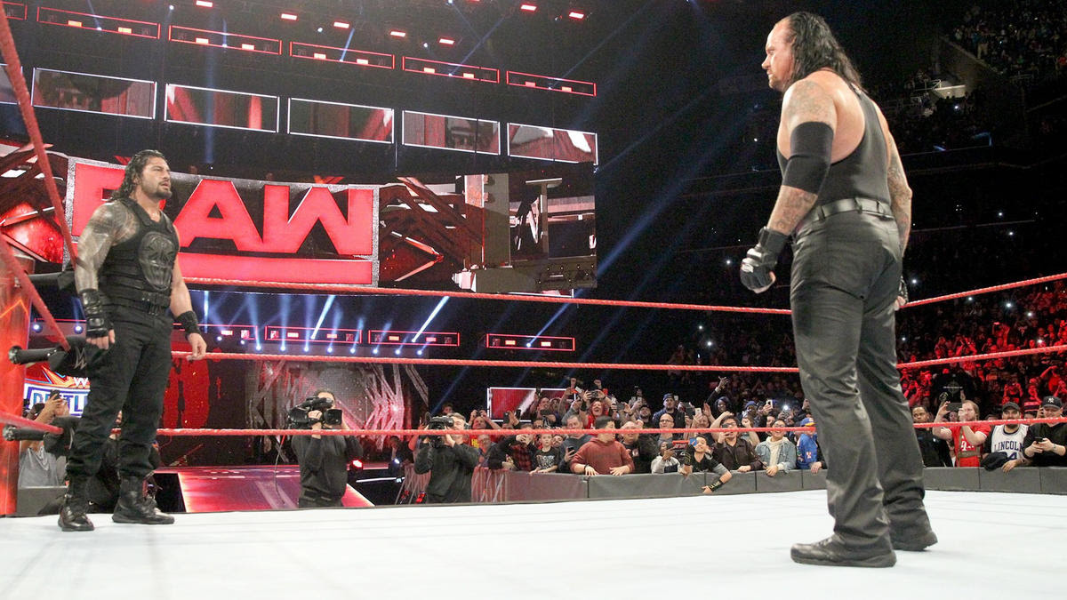 But just when it seems Reigns is about to strike with the Spear, the lights go dark and sound of The Undertaker's legendary gong rings through the arena.