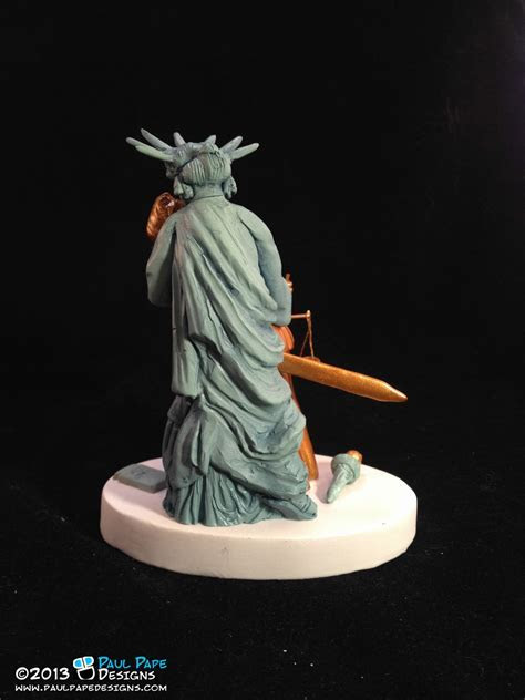 Paul Pape Designs   Lady Liberty kissing Lady Justice