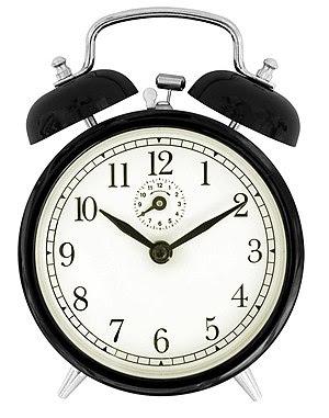 English: The face of a black windup alarm clock