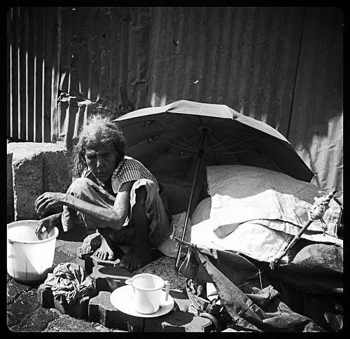 The Umbrella Lady of Bandra Reclamation by firoze shakir photographerno1
