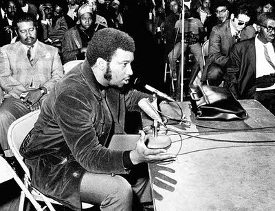 Black Panther Party deputy chairman of Illinois Fred Hampton speaking to a crowd in an undated photograph. Hampton, along with Mark Clark, were martyred on December 4, 1969 as a result of FBI and police actions. His legacy of struggle lives on today. by Pan-African News Wire File Photos
