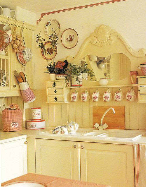 Especially love the repurposed dresser mirror over the kitchen sink.