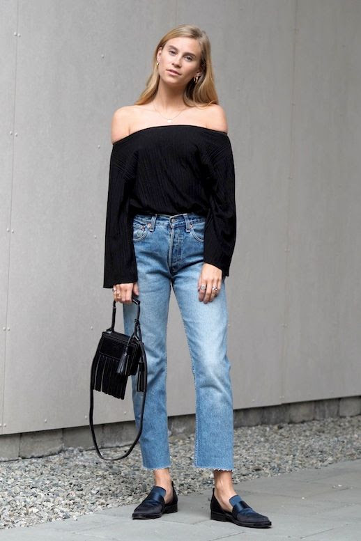 Le Fashion Blog Blogger Style Gold Hoop Earrings Black Off The Shoulder Top Vintage Jeans Fringe Mini Bag Loafers Via The Fashion Eaters