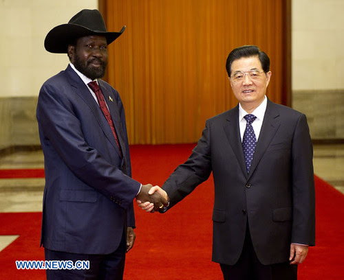 Chinese President Hu Jintao (R) shakes hands with South Sudanese President Salva Kiir Mayardit in Beijing, capital of China, April 24, 2012. Kiir cut short his visit to Beijing due to the escalating political and military situation inside the region. by Pan-African News Wire File Photos