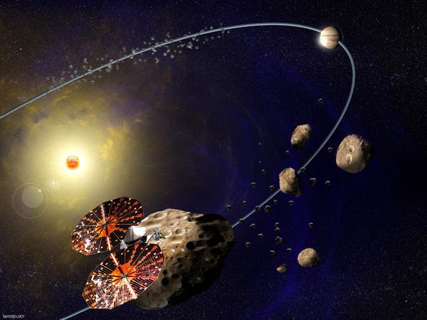 An artist's concept of the Lucy spacecraft exploring Trojan asteroids in Jupiter's orbit.