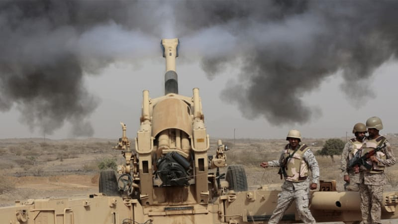 Saudi soldiers fire artillery towards three armed vehicles approaching the border with Yemen [File:Hasan Jamali/AP]