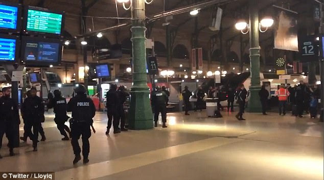 Armed police have sealed off the Gare du Nord station in Paris tonight, pictured, as part of a huge security operation