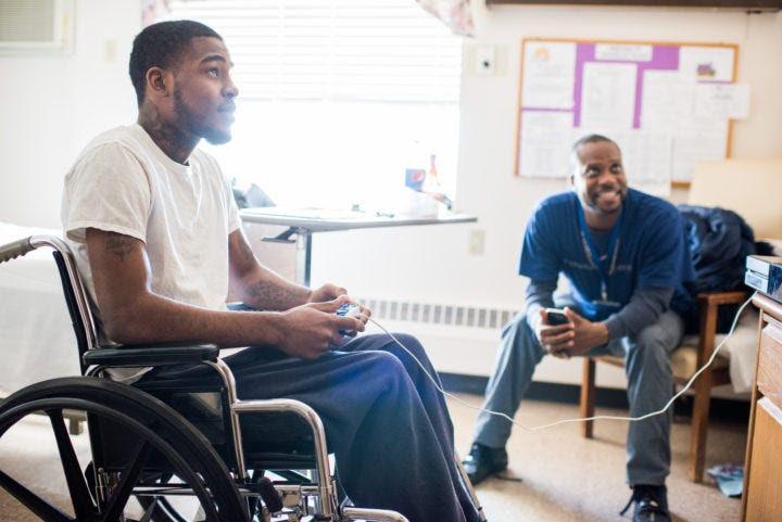gunshot survivor gunshot victim hospital wheelchair
