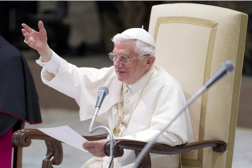Pope Benedict XVI waves as he leads his Wednesday general audience in Paul VI hall at the Vatican