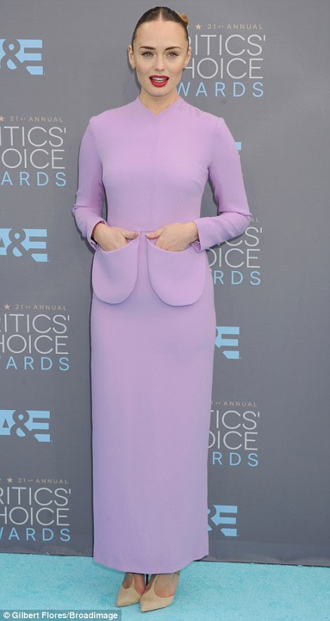 Turning heads for the wrong reasons: Abbey andLaura Haddock were making fashion statements on the blue carpet