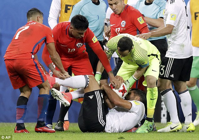 Chile players surround Germany midfielder Emre Can as he attempts to hold on to the ball