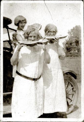 three women and watermelon