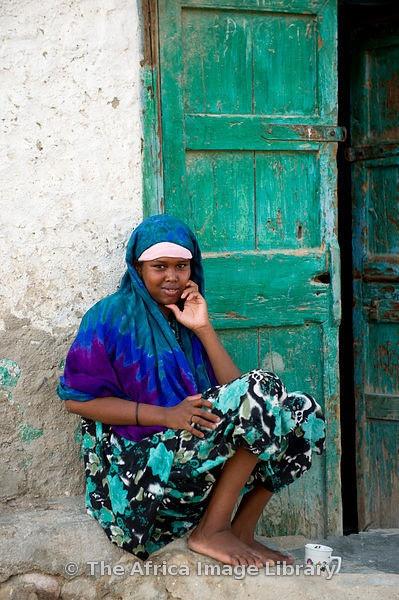 Woman outside her house, Berbera, Somaliland, Somalia
