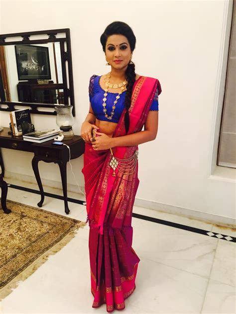 Red reception saree with Braid Hairstyle   Photo Gallery