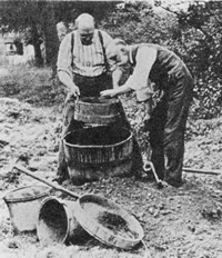 Charles Dawson and Arthur Smith Woodward sieving excavated material at Piltdown in Sussex.