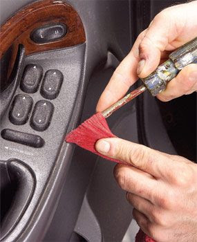 A flat screwdriver and a rag cleans most dash details.