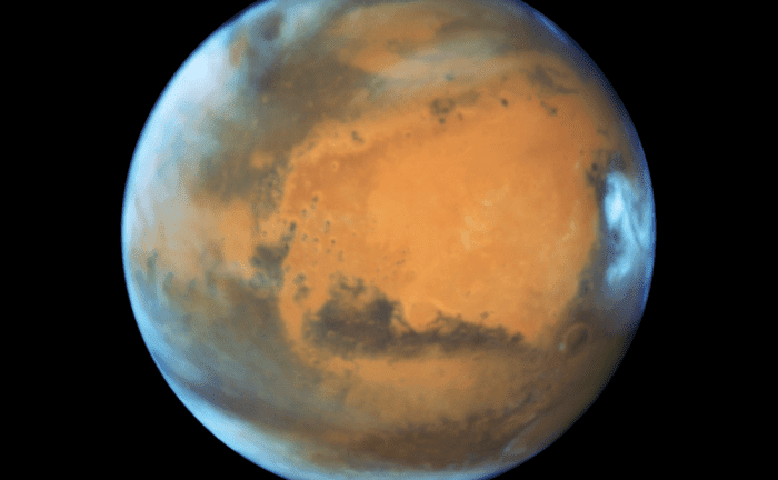 Mars in all its red-hued glory. Image: NASA, ESA, the Hubble Heritage Team (STScI/AURA), J. Bell (ASU), and M. Wolff (Space Science Institute)