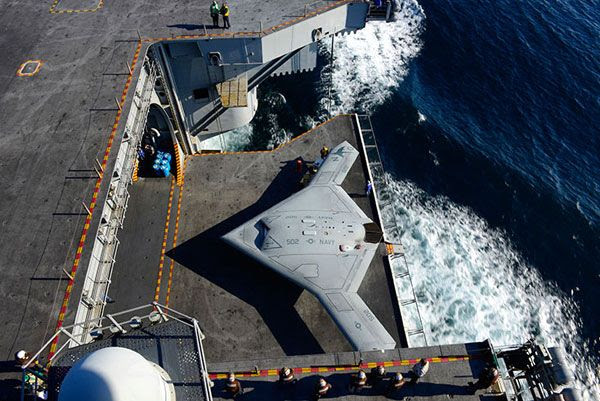 An elevator is about to take the X-47B UCAV up to the flight deck of the USS George H.W. Bush for its first catapult launch, on May 14, 2013.